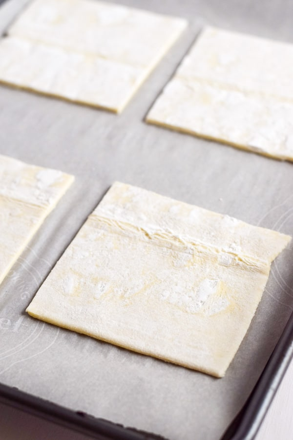 Cut puff pastry ready to be topped for the tart