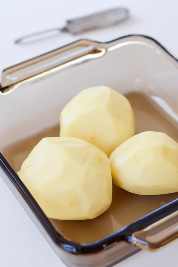 Potatoes all washed, peeled and ready to be sliced for the scalloped potato casserole