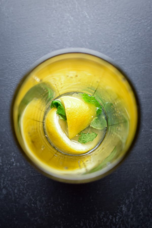 Arial view of the muddled mint, simple syrup and lemon for the wonderfully delicious whiskey smash