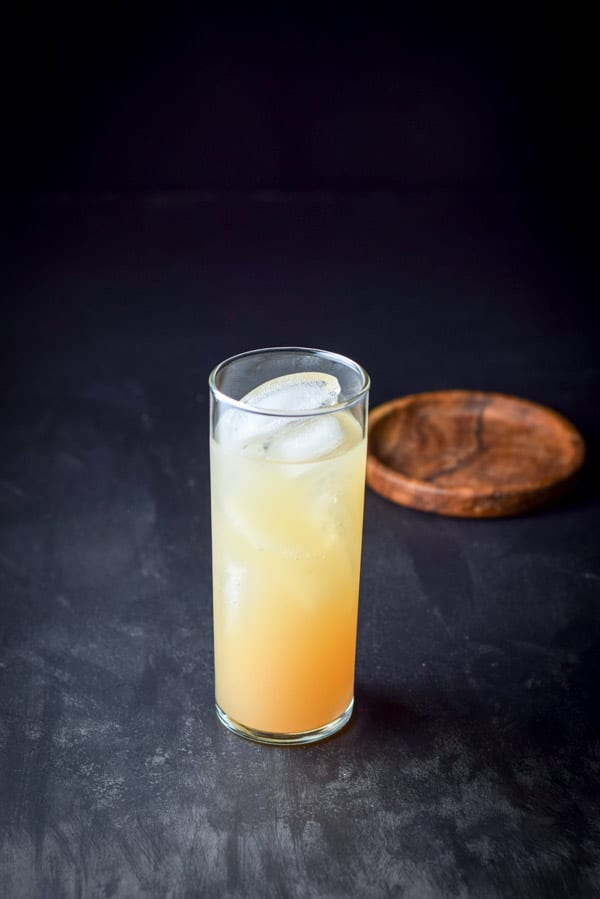 All the ingredients except the club soda into the great grapefruit Paloma cocktail
