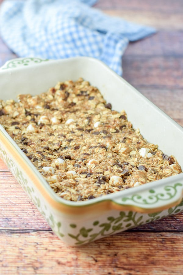 Healthy s'mores granola bars pressed into a baking dish
