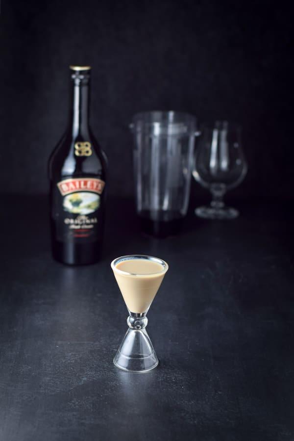 Baileys Irish cream measured for Nancy's Indulgent Delicious Frozen Mudslide Cocktail