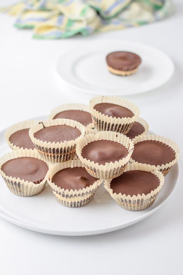 Pile of dark chocolate caramel marshmallow cashew butter cups