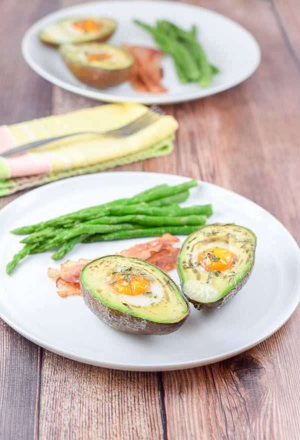 Plated healthy eggs nestled in avocado ready to eat